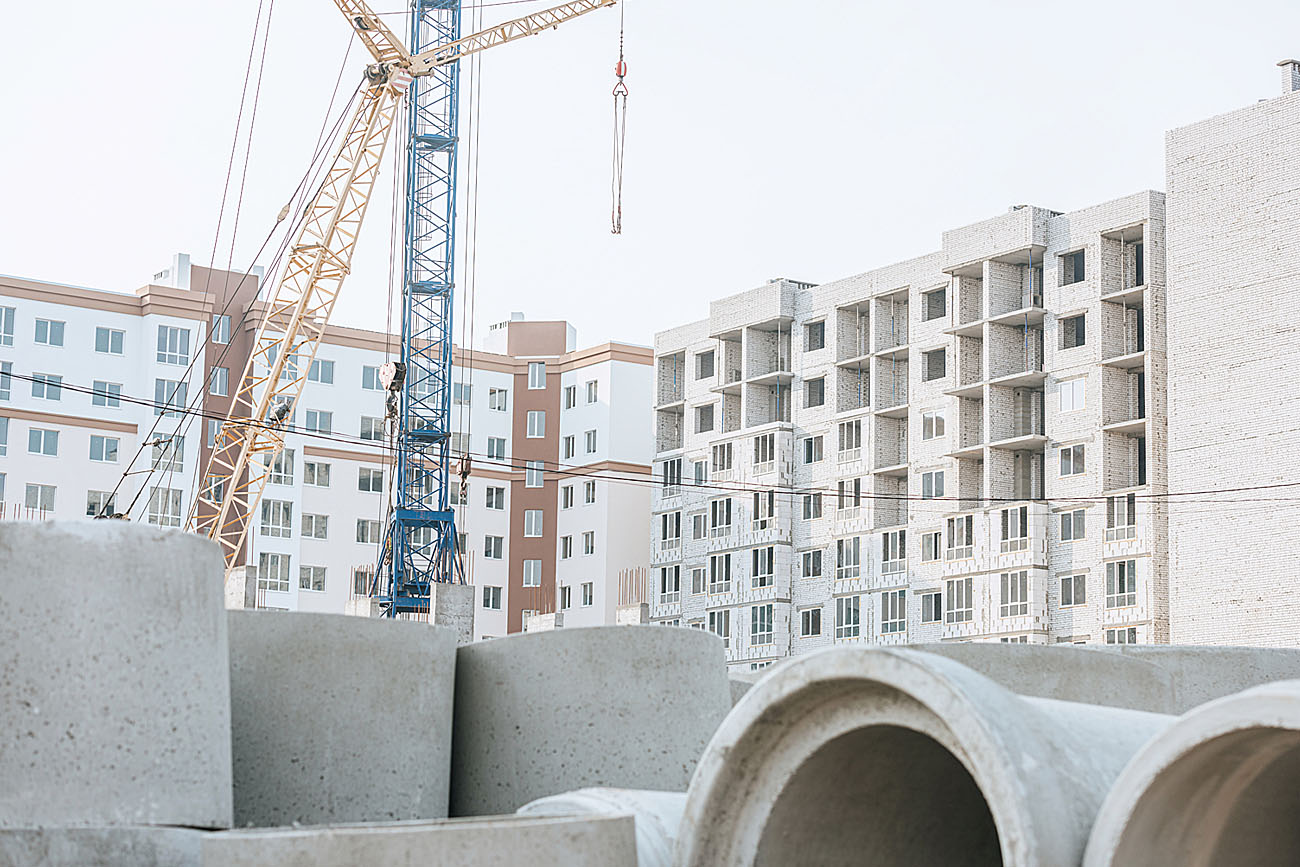 Concrete materials with construction site background