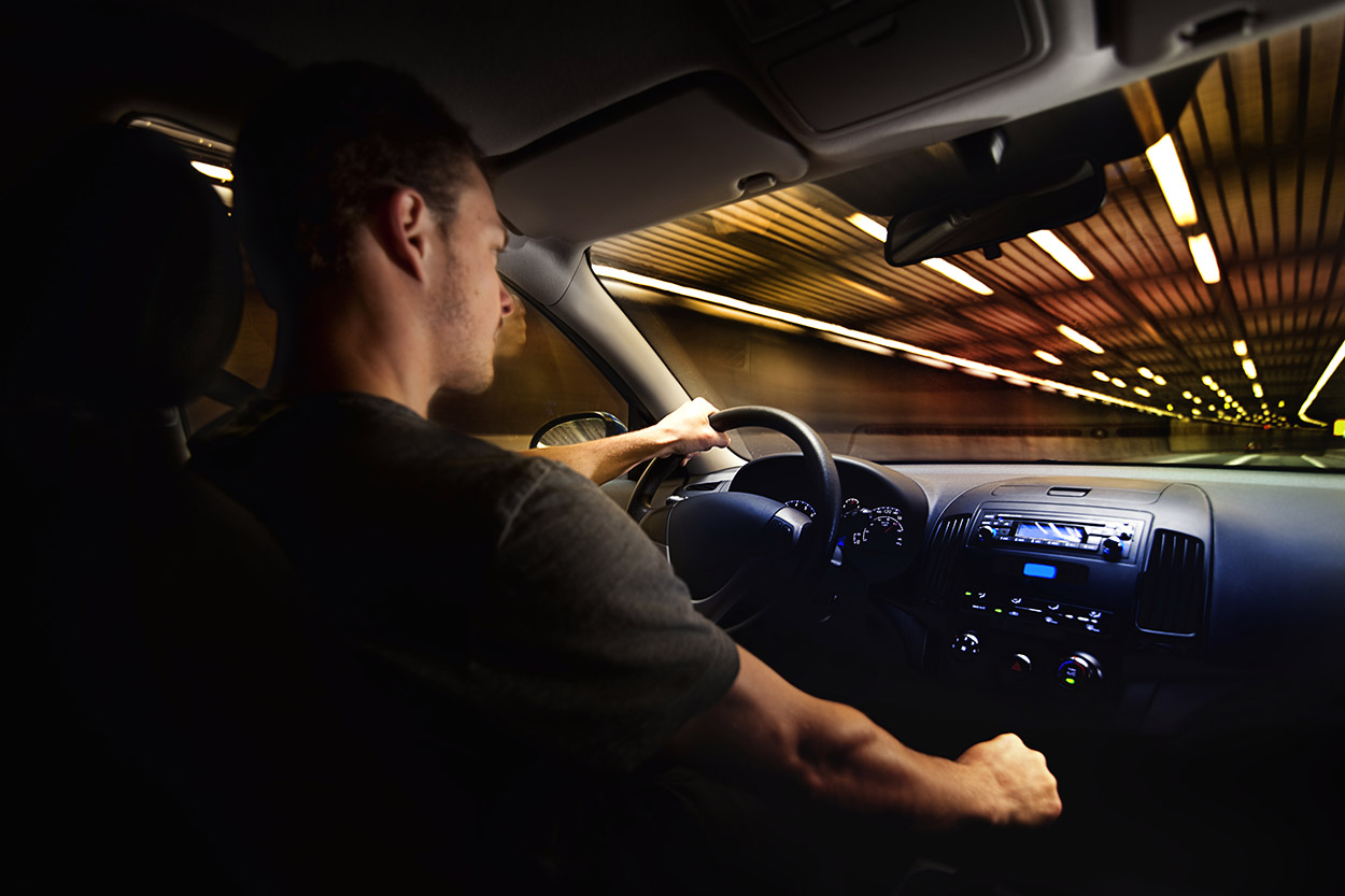 Young adult safely driving at night