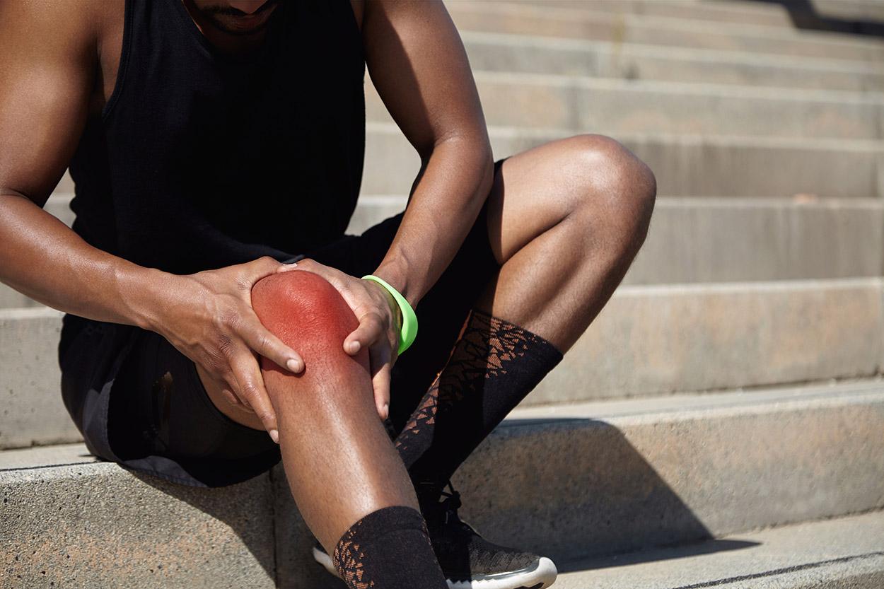 Main Touching Injured Leg