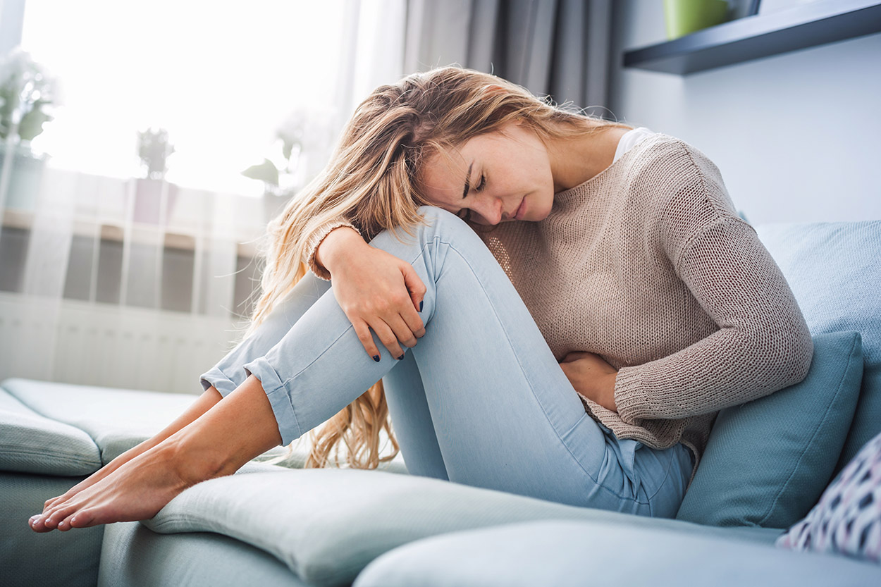 Woman having painful period