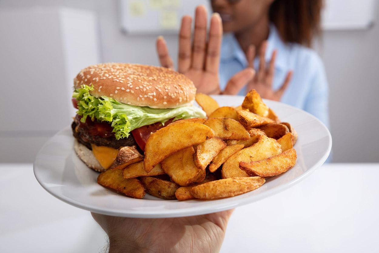Woman refusing a burger