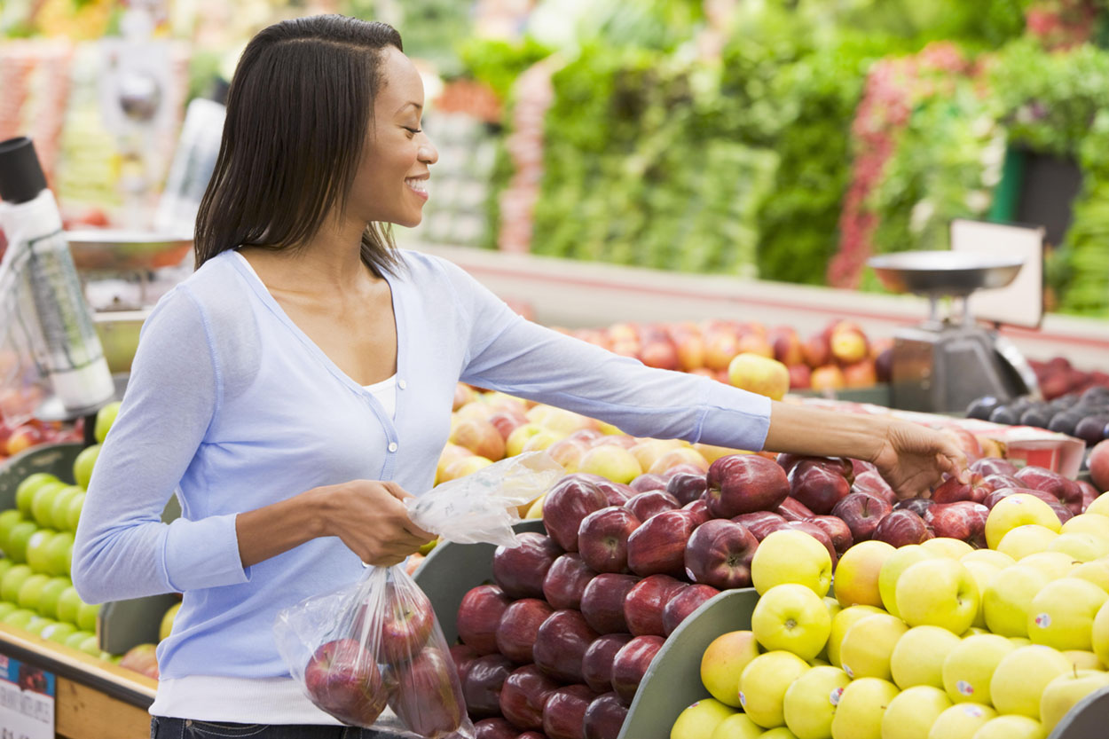 Woman Choosing Healthy in Grocery Store