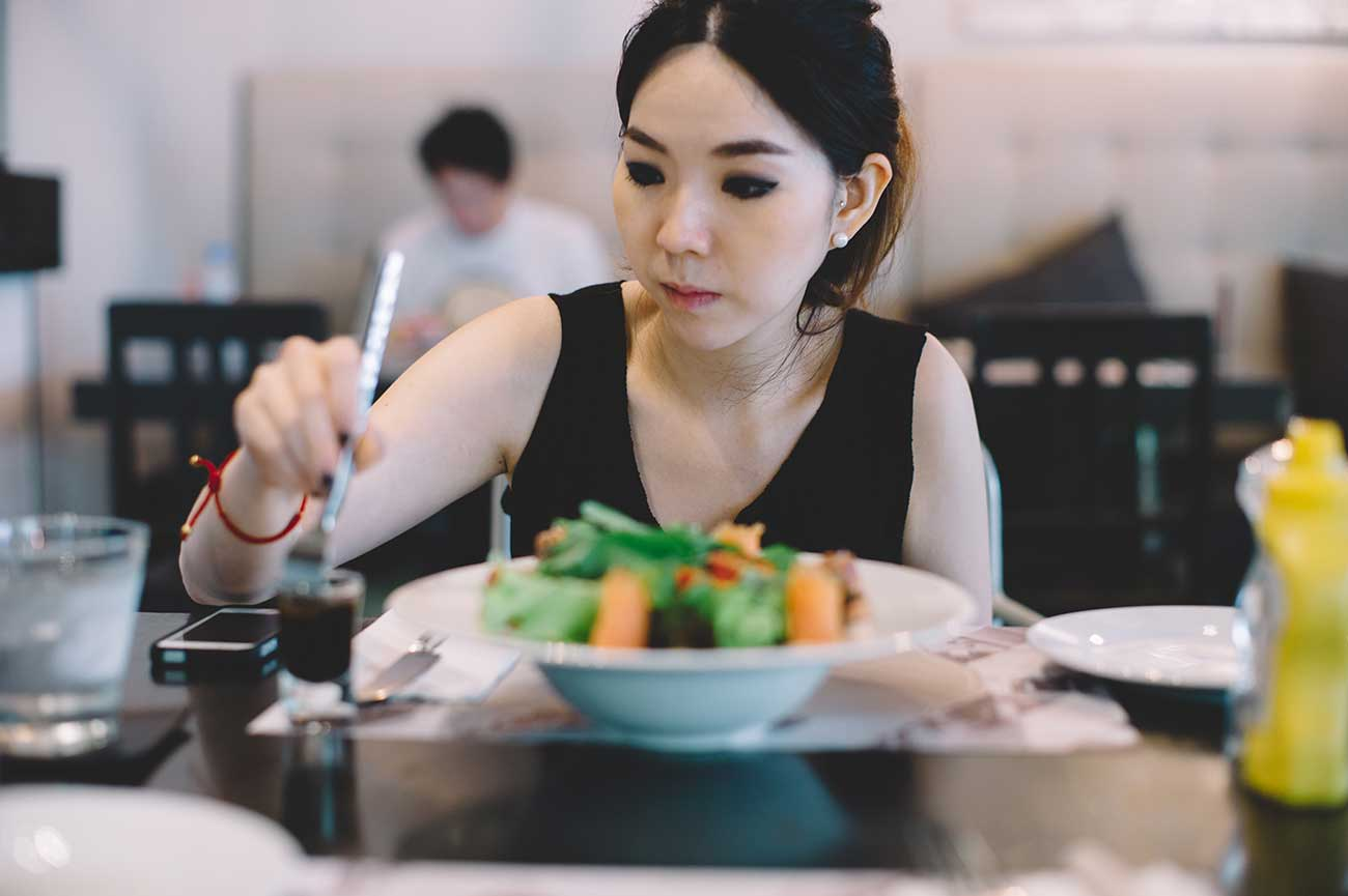 Asian Woman Eating a Healthy Lunch.